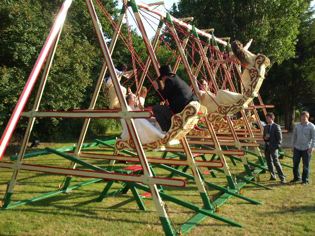 Swingboats - swing boats for hire. Traditional, victorian fairground attraction. Rent a traditional funfair swing for your party or corporate event.